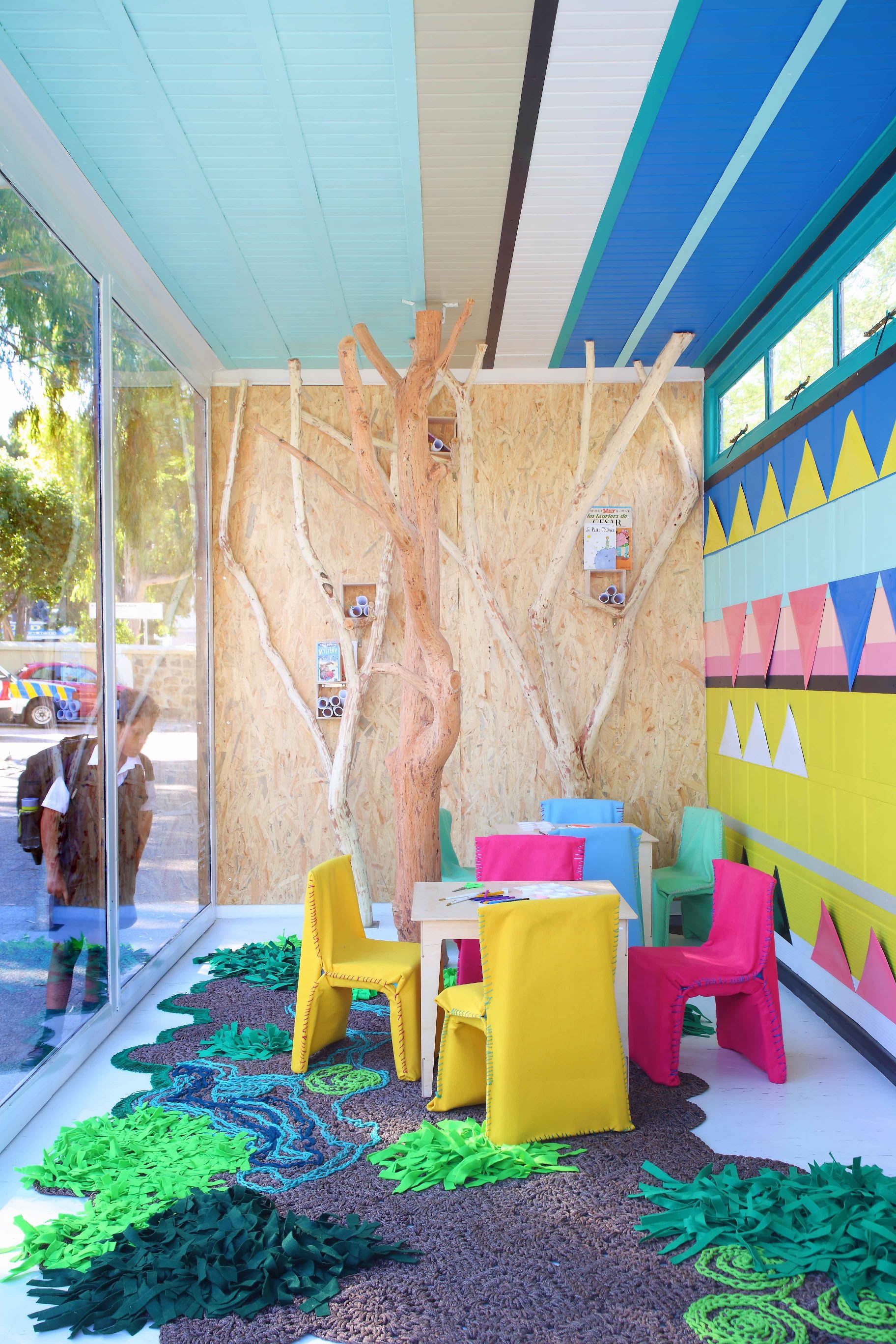 The COLOURS are soft yet bold and graphically representing earth, horizon and continuing up onto the ceiling to represent the sky. The magnetic stripes across the back wall also allow the geometrical SHAPES to be arranged by the children in different patterns, allowing them to change their own environment.  The colours therapeutic qualities are explored to create a space that is both calming and inspiring